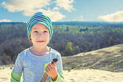 Boy with a stick walks on nature Royalty Free Stock Photo