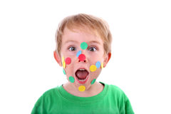 Boy with stickers on his face stock photo
