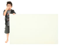 Boy with Stinky Face Expression Holding Blank Sign Stock Image
