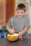 Boy Stirring Batter Royalty Free Stock Photography