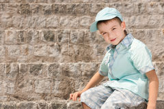 A boy on the stone steps Stock Photo
