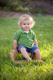 Boy on Stool Royalty Free Stock Images