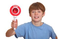 Boy with stop sign Stock Photography