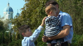 Boy straightens clothes little brother stock footage
