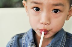 The boy with the straw Royalty Free Stock Image