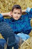 Boy with straw Stock Photos