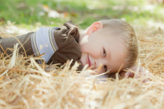Boy in Straw Stock Images
