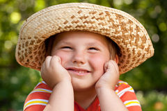 Boy in a straw hat Stock Photography