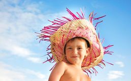 Boy in straw hat over sky background Royalty Free Stock Photography