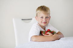 Boy with strawberries. Little funny boy with strawberries Stock Photo