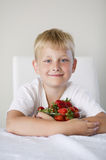 Boy with strawberries. Little funny boy with strawberries Royalty Free Stock Photo