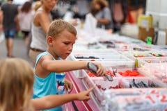 Boy on street fruit market in SPain. Boy on summer street fruit market in SPain stock image