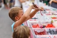 Boy on street fruit market in SPain. Boy on summer street fruit market in SPain royalty free stock photos