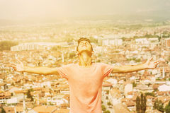 Boy stretch his arms in the sky Royalty Free Stock Photo