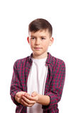 The boy stretched his arms in front of him. The boy folded his arms scoop, in the background the white background, Cute student Stock Photography