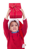 Boy stretches out a present Royalty Free Stock Image