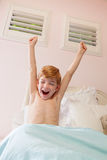 Boy stretches and yawns Stock Image