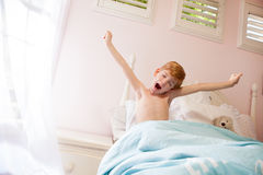 Boy stretches and yawns Royalty Free Stock Photo