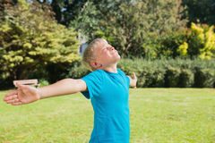 Boy stretching his arms and enjoying the sun Royalty Free Stock Photos
