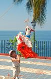 Boy strikes a piñata in Puerto Vallarta, Mexico Royalty Free Stock Photography