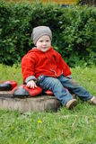 Boy in striped hat. And orange jacket Royalty Free Stock Photography