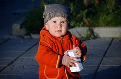 Boy in striped hat. And orange jacket Stock Photo