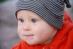 Boy in striped hat. And orange jacket Stock Image