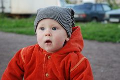 Boy in striped hat. And orange jacket Stock Photography