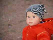 Boy in striped hat. And orange jacket Royalty Free Stock Photos