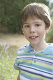 Boy In Striped Polo Tshirt Outdoors Royalty Free Stock Images