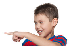 Boy in striped shirt shows her finger to the side Royalty Free Stock Photo