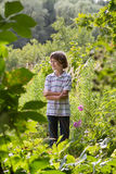 Boy in striped T-shirt in a botanical park. Adorable boy in striped T-shirt in a botanical park royalty free stock images