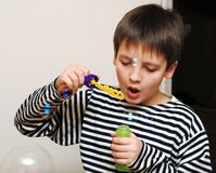 Boy in striped vest and bubbles Stock Photography