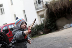 Boy on stroller with a dagger toy Stock Image