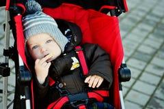 Boy in stroller Stock Images