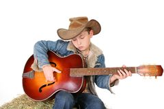 Boy strumming guitar Royalty Free Stock Image