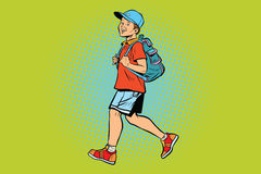Boy student with a backpack goes to school or Hiking Stock Photo