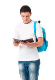 Boy student with backpack and notepad. Isolated on white background Royalty Free Stock Images