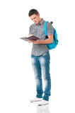 Boy student with backpack and notepad. Isolated on white background Royalty Free Stock Photography