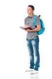 Boy student with backpack and notepad. Isolated on white background Stock Images