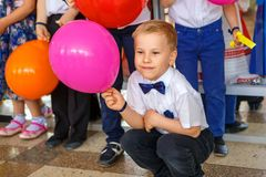 Boy student with a balloon at the festival stock photos