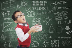 Boy student humor expression in class Stock Image