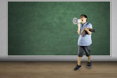 Boy student with megaphone in the class Royalty Free Stock Photos