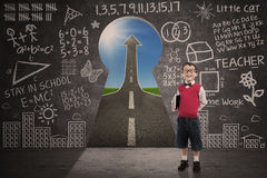 Boy student smiling in class with success road behind keyhole Stock Image