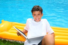 Boy student teen vacation homework pool float Royalty Free Stock Photo