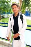 Boy student teenager backpack holding books. At home outdoor smiling Royalty Free Stock Image