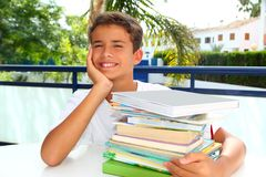Boy student teenager happy thinking with books Stock Image