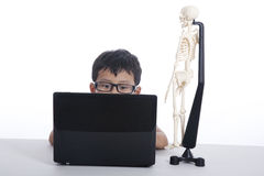 Boy studies human anatomy with his laptop Stock Photos