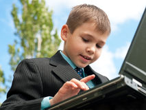 Boy studies outside Royalty Free Stock Images