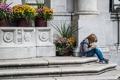 Boy studying in Bryant Park New York Stock Photo